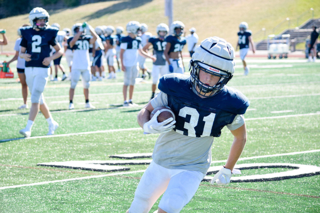 Junior Patrick McKenzie runs to the endzone during football practice on Aug. 27, 2019, at Glacier Peak High School in Snohomish. (Katie Webber / The Herald)