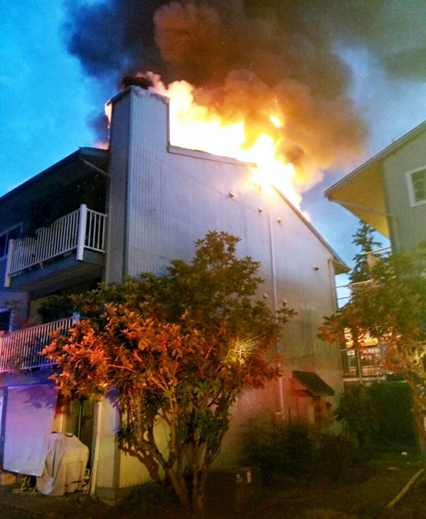 Fire crews were called twice to the same condominium building in Lynnwood. The second time they confronted large flames coming from the attic. (South County Fire)
