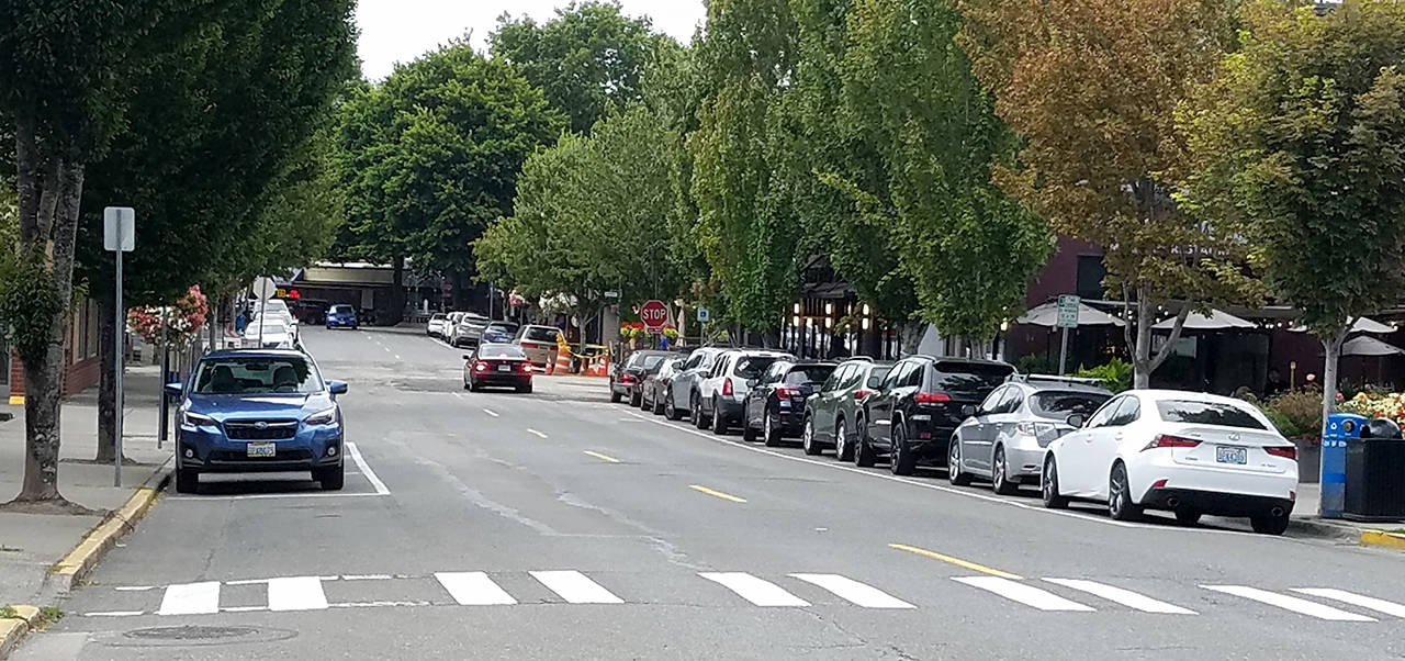 Parked cars line Fifth Avenue in downtown Edmonds on Thursday afternoon. (Sharon Salyer / The Herald)