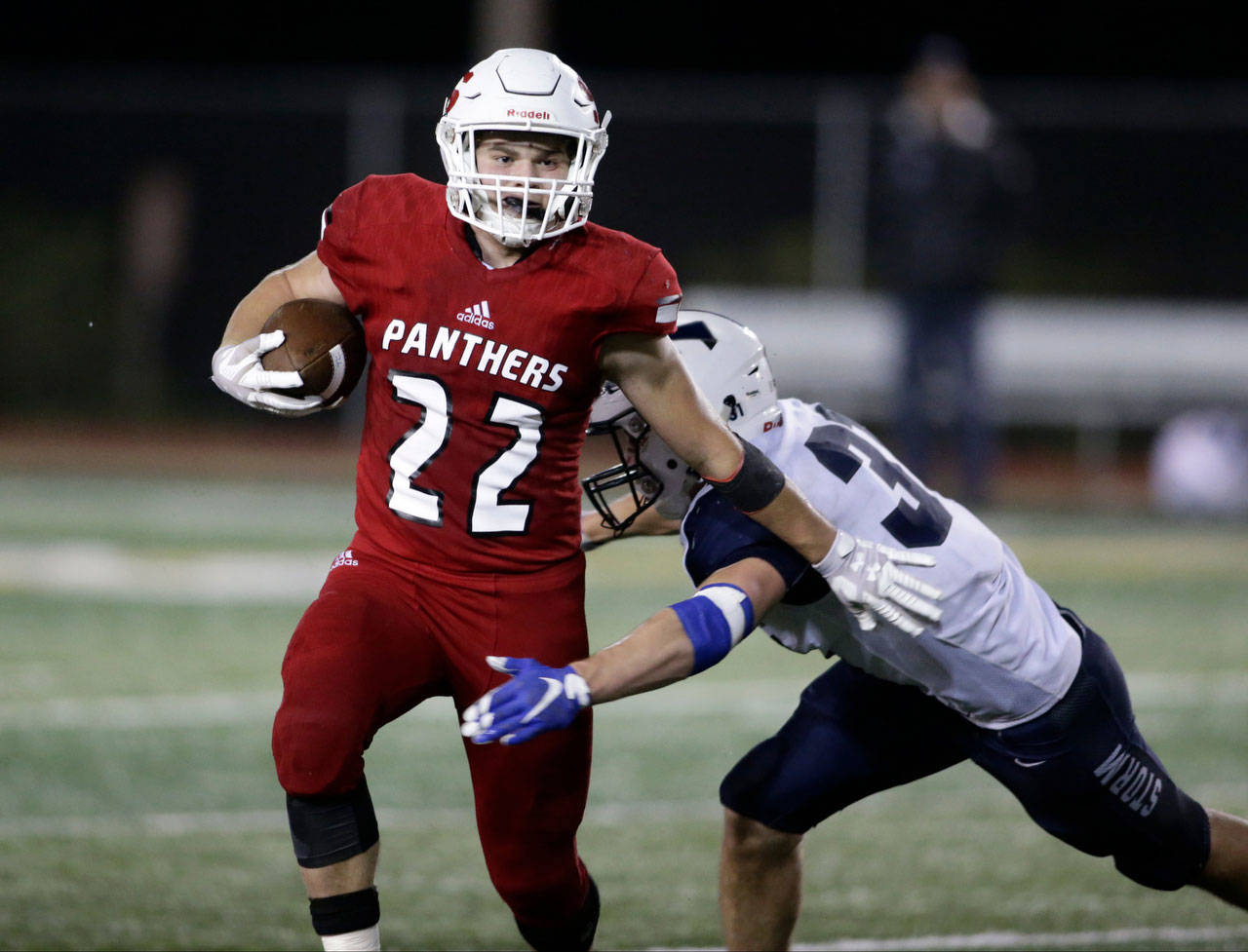 Snohomish's Tyler Larson pushes off an opponent during Snohomish's 30-27 win over Squalicum at Veterans Memorial Stadium on Oct. 26, 2018 in Snohomish. Tha Panthers enter the season as a the favorite to win the conference. (Andy Bronson / The Herald)