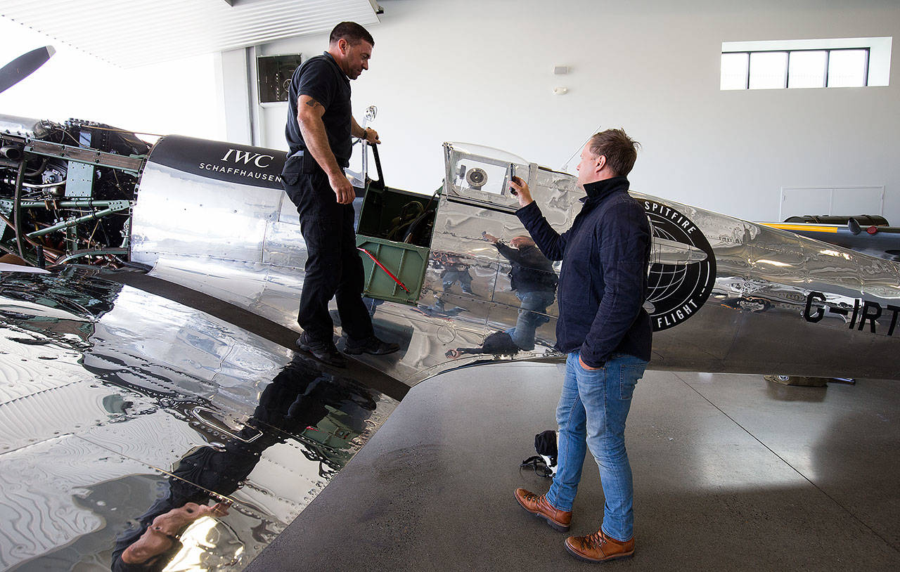 Ben Uttley (right) records a video with Gerry Jones answering questions about the Silver Spitfire. (Andy Bronson / The Herald)