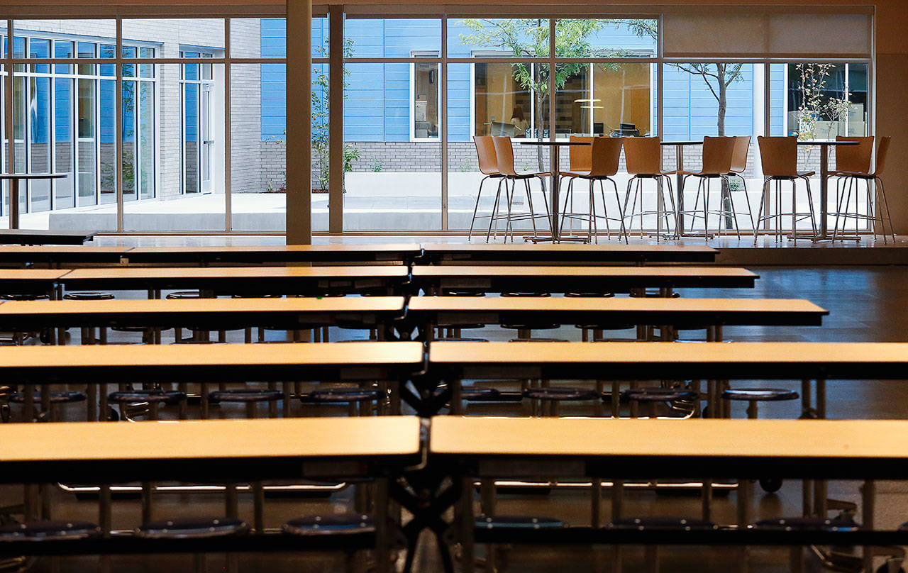 At the new North Middle School, a roomy commons and cafeteria look out on a courtyard, accessible only from inside the school's building. (Dan Bates / The Herald)