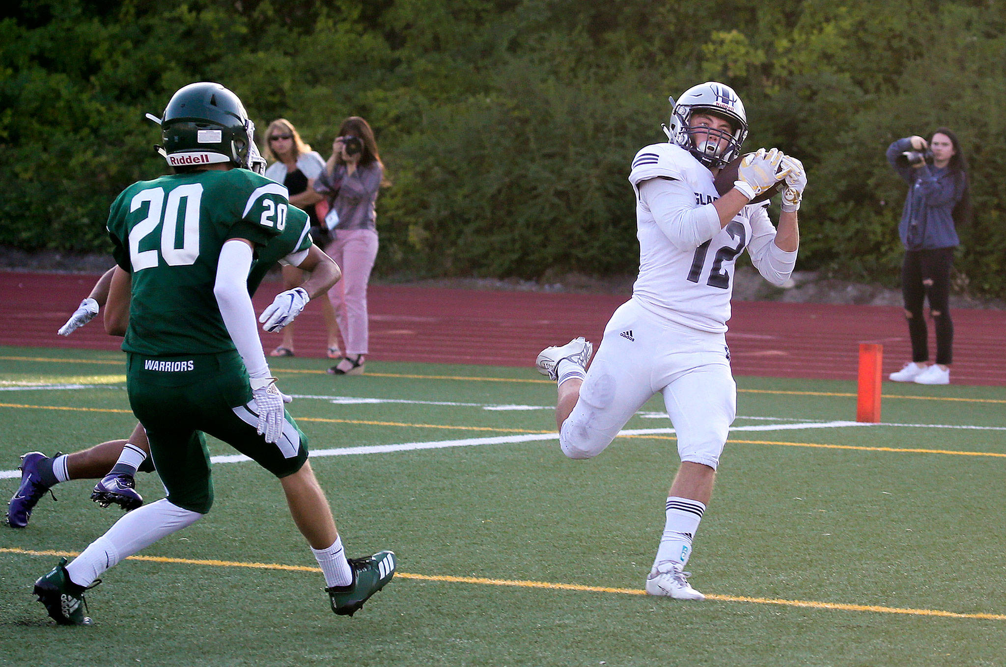 Glacier Peak's Brayden Corwin hauls in a pass for a touchdown as Glacier Peak beat Edmonds-Woodway 35-14, in their season opening football game for both teams, at Edmonds Stadium on Friday, Sept. 6, 2019 in Edmonds, Wash. (Andy Bronson / The Herald)