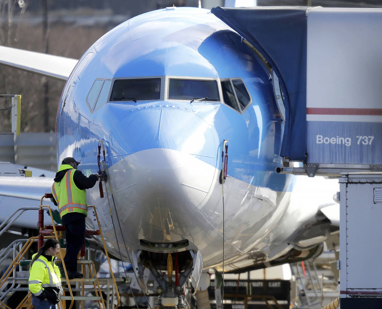 In this March 13 photo, a worker stands on a platform near a Boeing 737 Max 8 airplane being built for TUI Group at Boeing Co.'s Renton Assembly Plant in Renton. (AP Photo/Ted S. Warren, File)