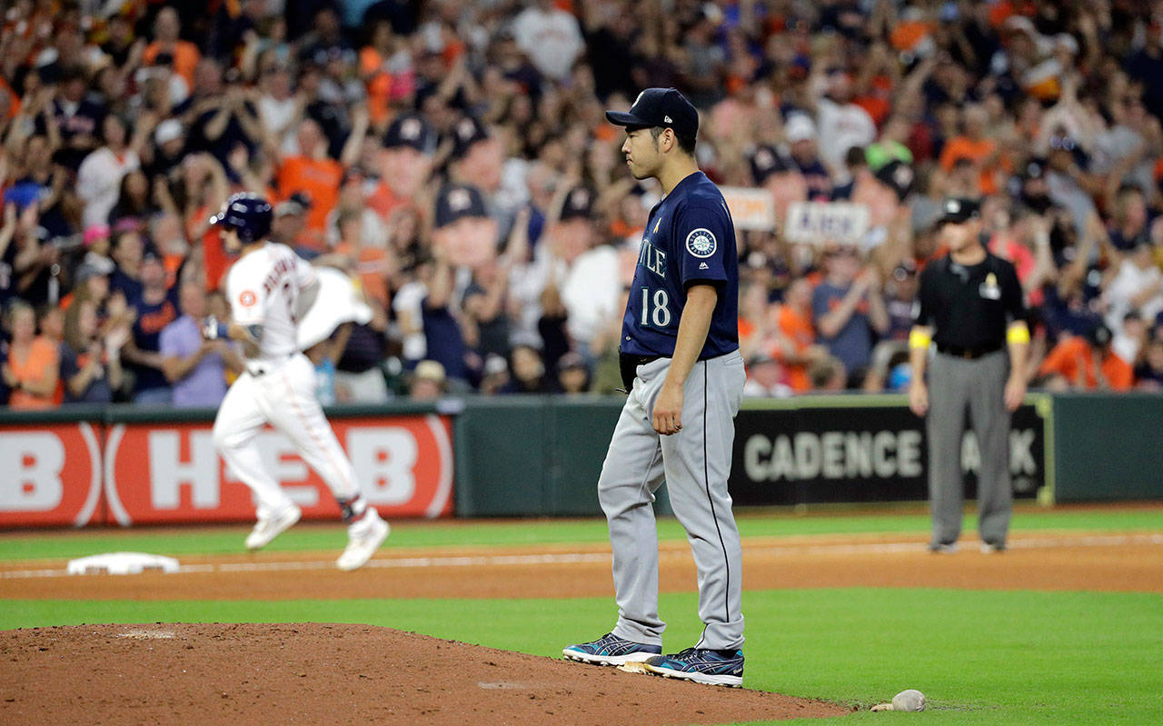 Mariners starting pitcher Yusei Kikuchi (right) stands on the back of the mound after giving up a home run to the Astros' Alex Bregman (left) during the sixth inning of a game Sept. 7, 2019, in Houston. (AP Photo/David J. Phillip)