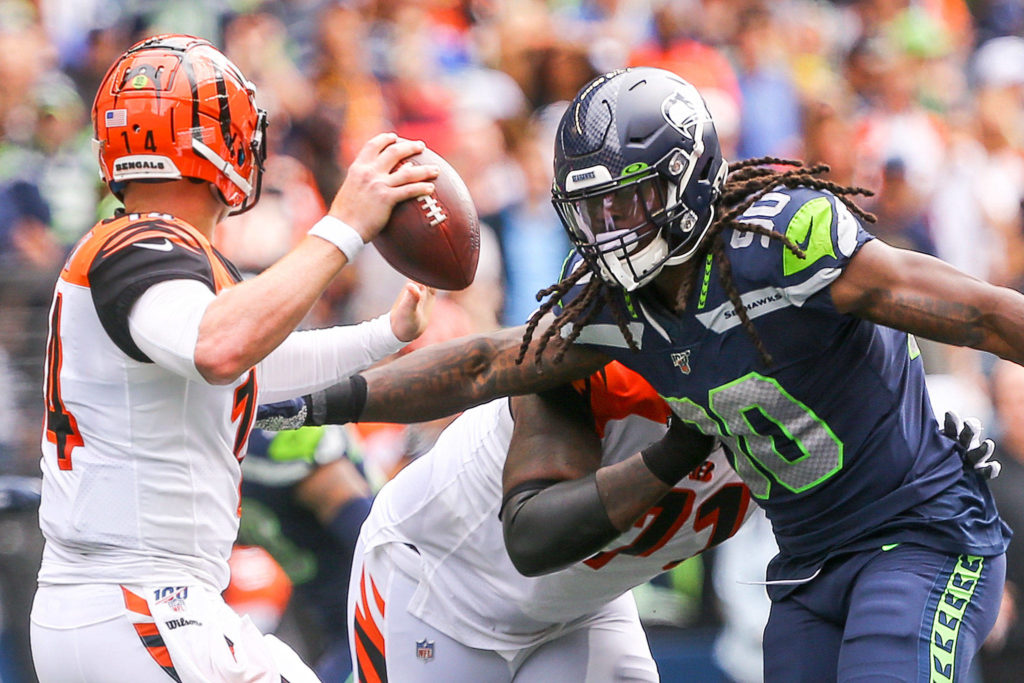 Seattle's Jadeveon Clowney rushes Cincinnati's quarterback Andy Dalton at CenturyLink Field Sunday afternoon in Seattle on September 8, 2019. The Seahawks won 21-20. (Kevin Clark / The Herald)