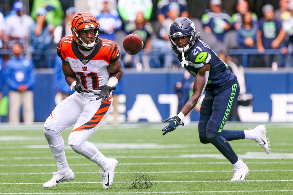 Cincinnati's John Ross III looks to make a catch with Seattle's Marquise Blair trailing at CenturyLink Field Sunday afternoon in Seattle on September 8, 2019. The Seahawks won 21-20. (Kevin Clark / The Herald)