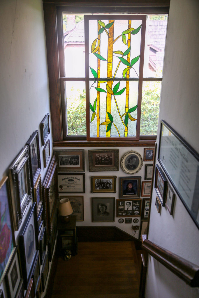 A stained glass panel and photos decorate the main stairase at the Hendrie house. (Kevin Clark / The Herald) A stained glass panel and photos decorate the main staircase at the home of Candice Jarrett and husband David Cordell. (Kevin Clark / The Herald)