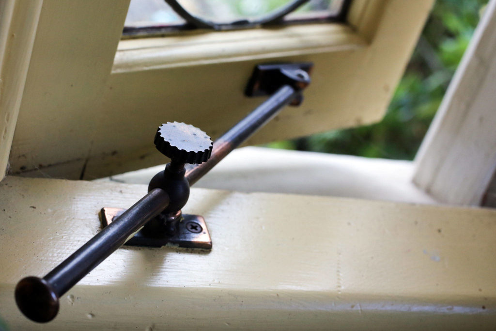 Original window hardware of The Hendrie house of 1902 in Snohomish and part of the upcoming historic homes tour. (Kevin Clark / The Herald) Original window hardware of the 1902 home.	(Kevin Clark / The Herald)
