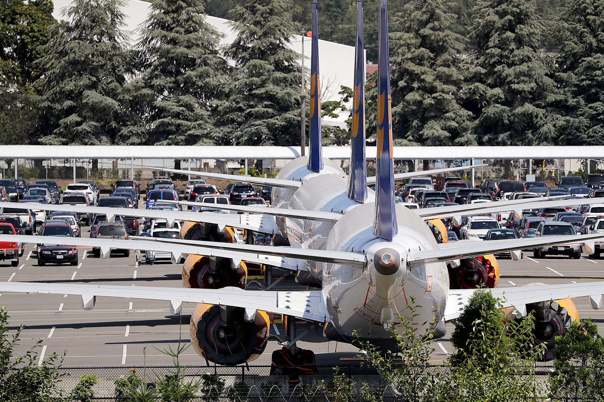 Grounded Boeing 737 Max airplanes, built for Icelandair, are parked in a lot normally used for cars in an area adjacent to Boeing Field in Seattle. (AP Photo/Elaine Thompson)