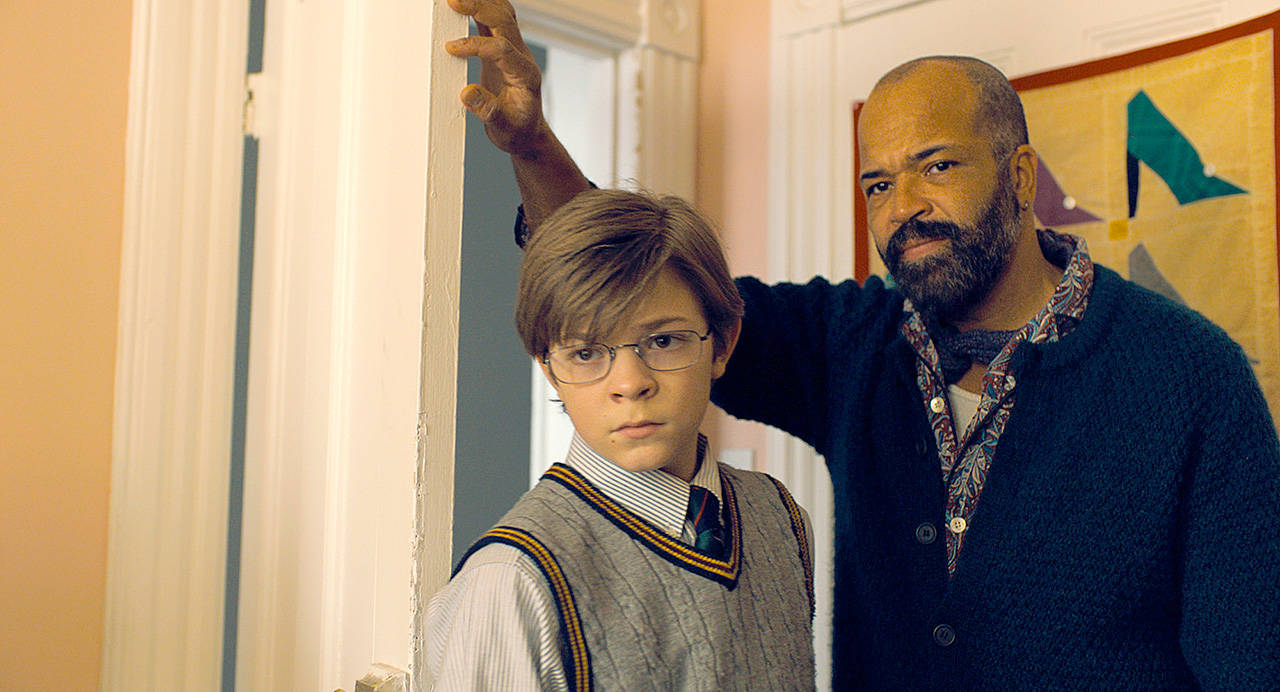 "Oakes Fegley (left) and Jeffrey Wright in ""The Goldfinch."" (Warner Bros. Pictures)"