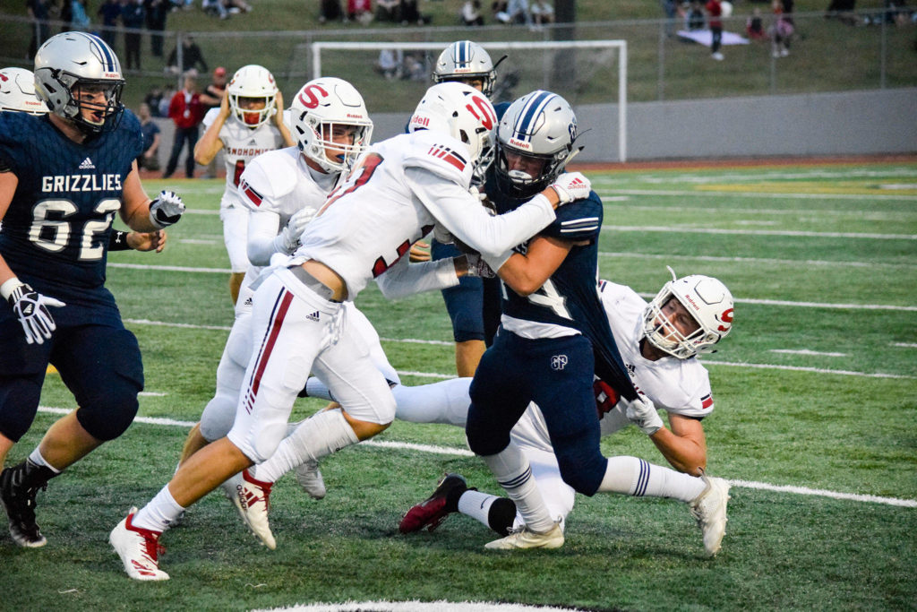 Senior wide receiver Jace Handshy chargers through the Snohomish defense on Friday, Sept. 13 at Veterans Memorial Stadium. (Katie Webber / The Herald)