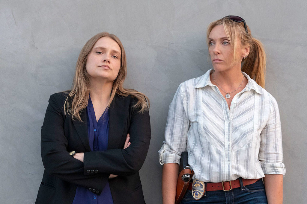 "Merritt Wever (left) and Toni Collette star in the drama ""Unbelievable."" (Beth Dubber / Netflix)"