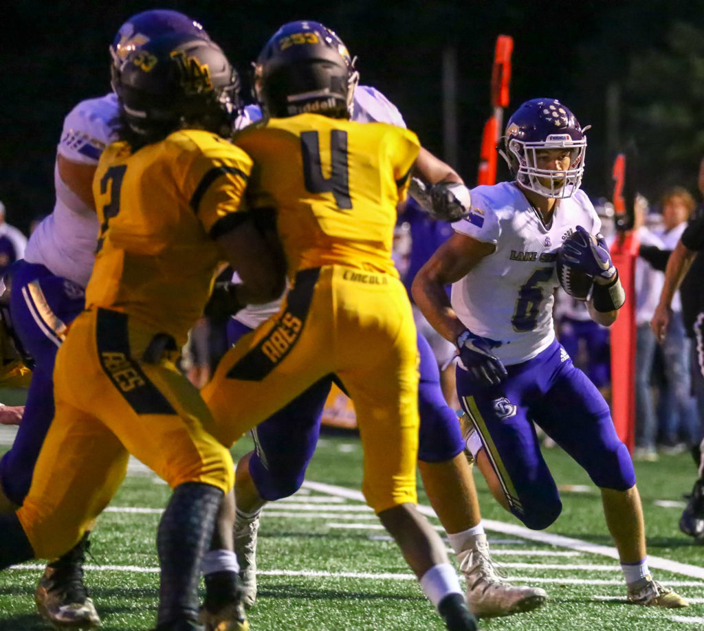 Lake Stevens' Dallas Landeros races for the end zone and the touchdown Friday night at Lincoln Bowl in Tacoma on September 13, 2019. Lake Stevens won 35-26. (Kevin Clark / The Herald)