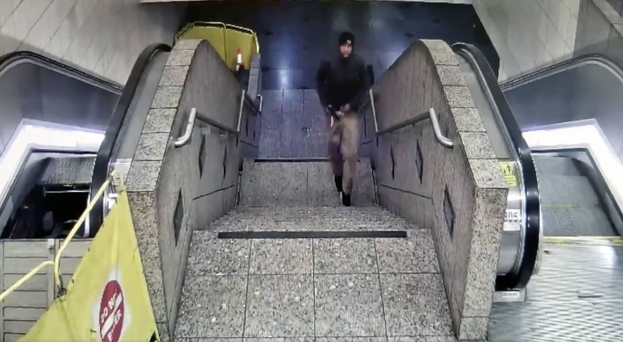 Detectives released surveillance video from the Westlake Station shooting, in which the suspect is shown fleeing tunnel with gun after the shooting. (Seattle Police Department)