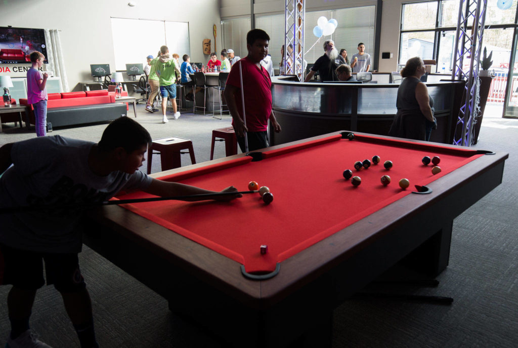 Kids play pool in the new Tulalip MultiMedia Teen Center on Wednesday. The center will be the Boys & Girls Clubs of the Snohomish County Tulalip Unit. (Andy Bronson / The Herald)