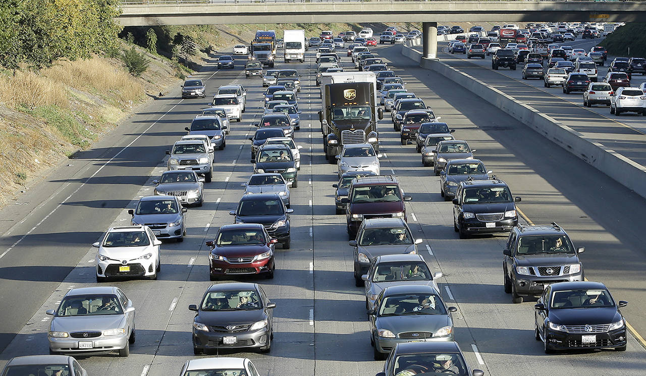 In this 2017 photo, vehicles crowd Highway 50 in Sacramento, California. (AP Photo/Rich Pedroncelli, File)