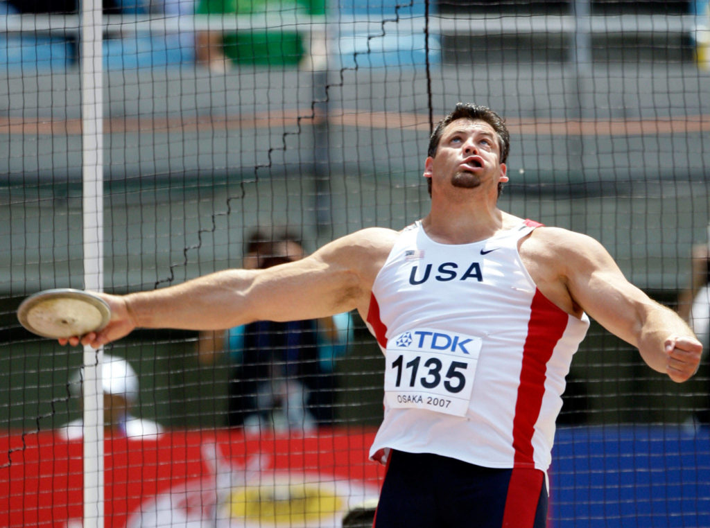 United States' Jarred Rome makes an attempt during qualification for the men's discus throw final at the World Athletics Championships on Aug. 26, 2007, in Osaka, Japan. (AP Photo/David J. Phillip)
