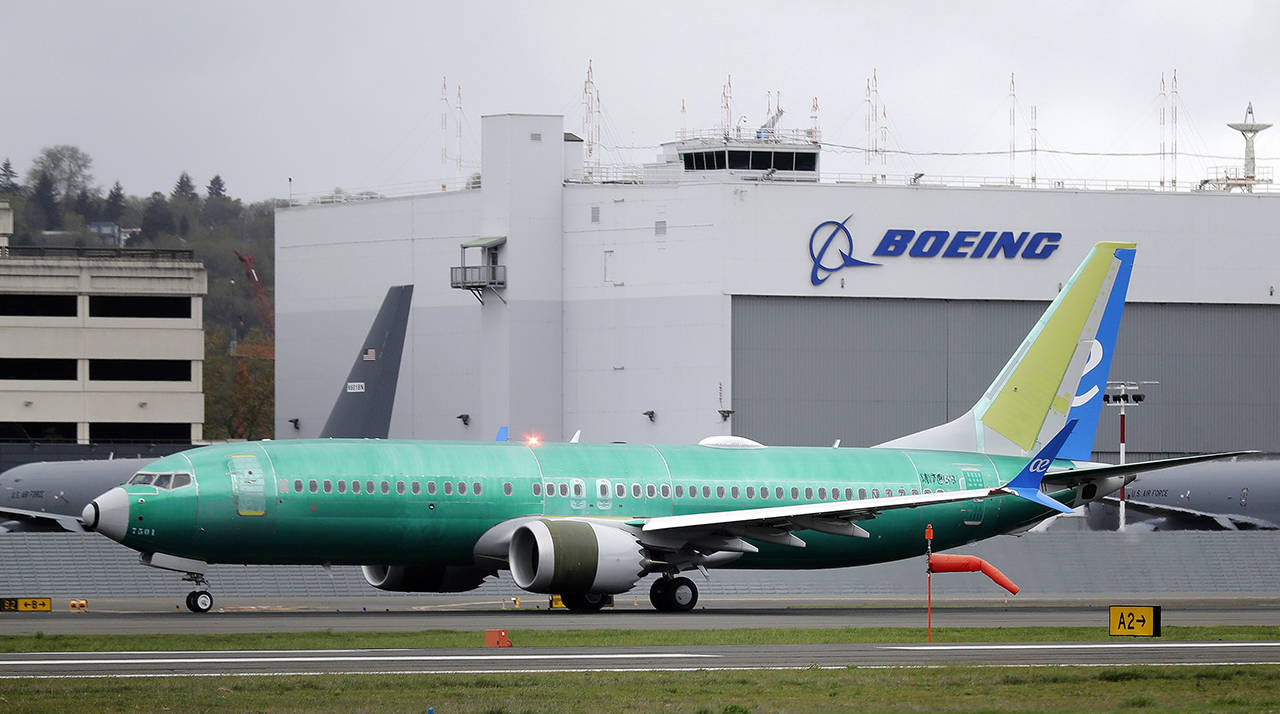 In this April 10 photo, a Boeing 737 MAX 8 airplane being built for Spain-based Air Europa rolls toward takeoff before a test flight at Boeing Field in Seattle. (AP Photo/Ted S. Warren, File)