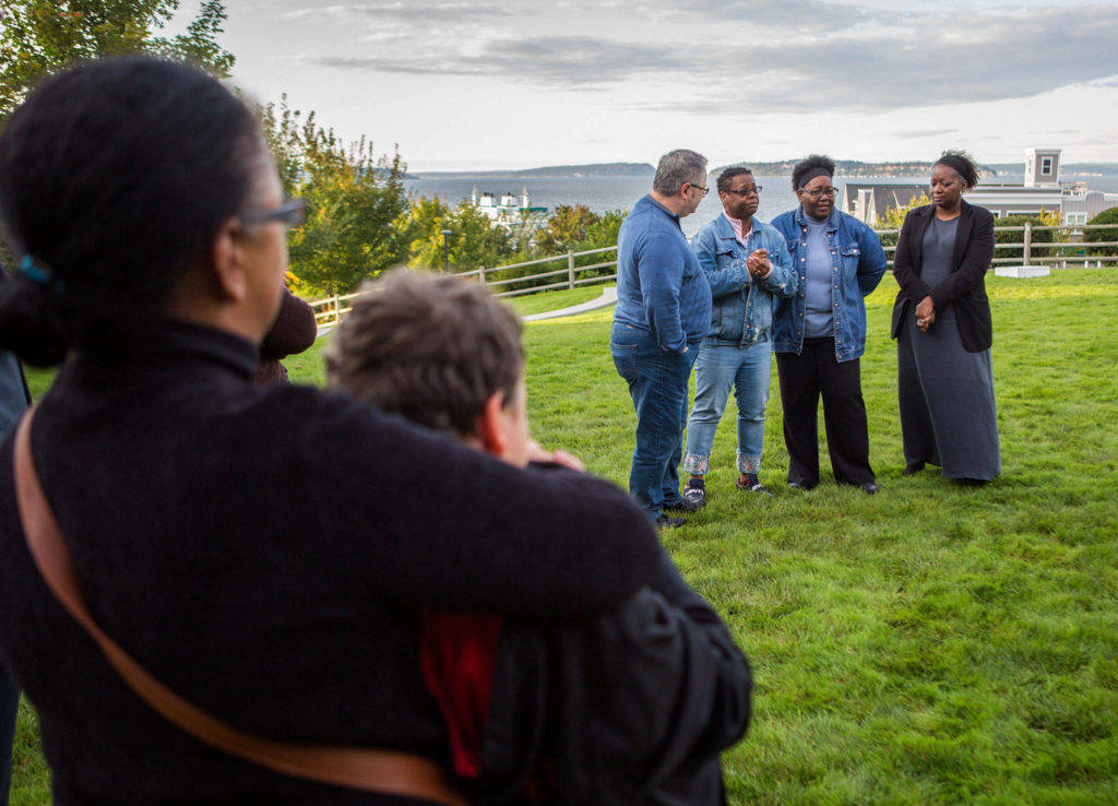 Ezekiel Kelly's family Ann Fields, right, Pam Fields, and LaTonage Kelly speak to a group of family, friends and officials involved in his murder case at a bench dedication at the Rosehill Community Center on Saturday, Sept. 28, 2019 in Mukilteo, Wash. (Olivia Vanni / The Herald)