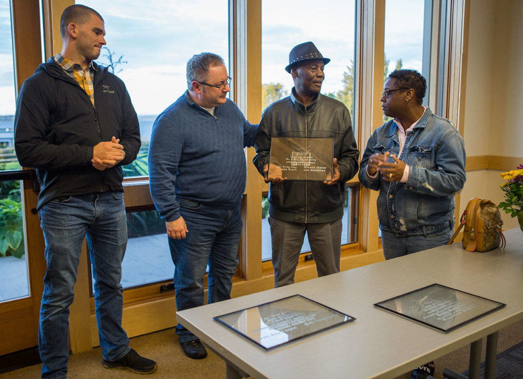 LaTonage Kelly, right, presents Sargent Andy Illyn, left, and Detective John Ernst with plaques thanking them for their work in Ezekiel's murder case at the Rosehill Community Center on Saturday, Sept. 28, 2019 in Mukilteo, Wash. (Olivia Vanni / The Herald)