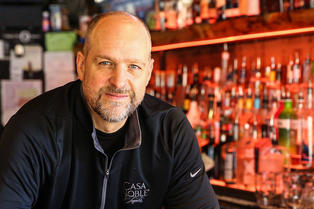"Mark Evich is the bar manager of The Cove Restaurant and Lounge in Lynnwood. With a career spanning 28 years, he calls himself a ""sage."" (Kevin Clark / The Herald)"