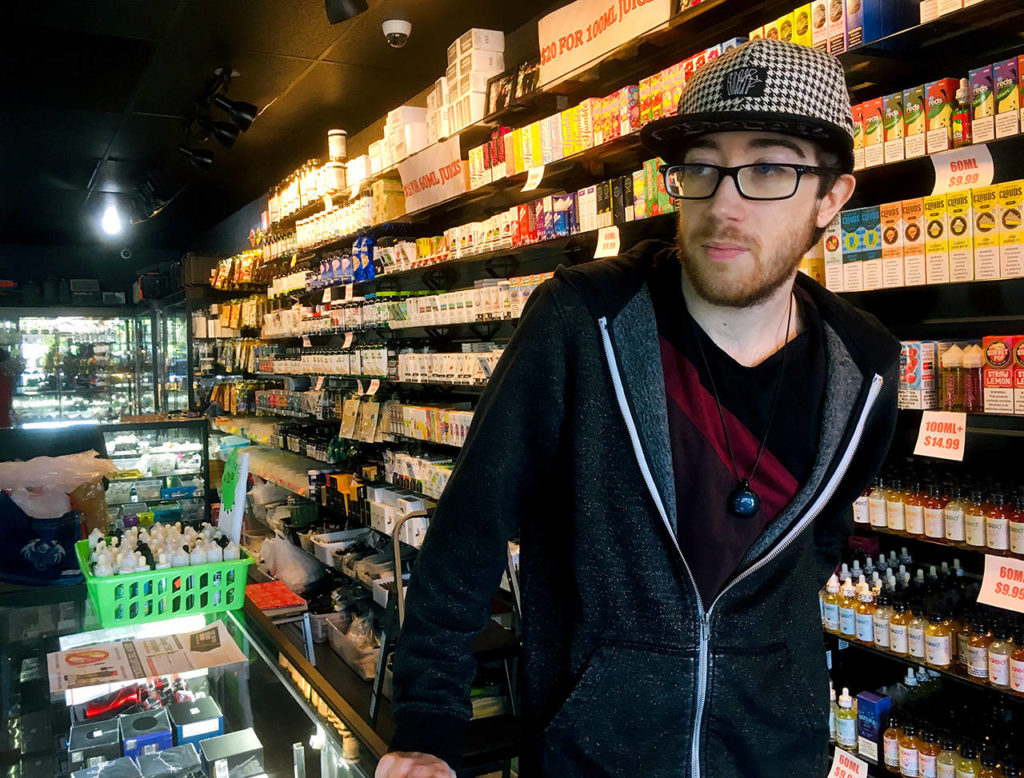 Employee Marcus Esmay talks about the proposed ban on vape flavors at the store he works at in Everett. (Sue Misao / The Herald)