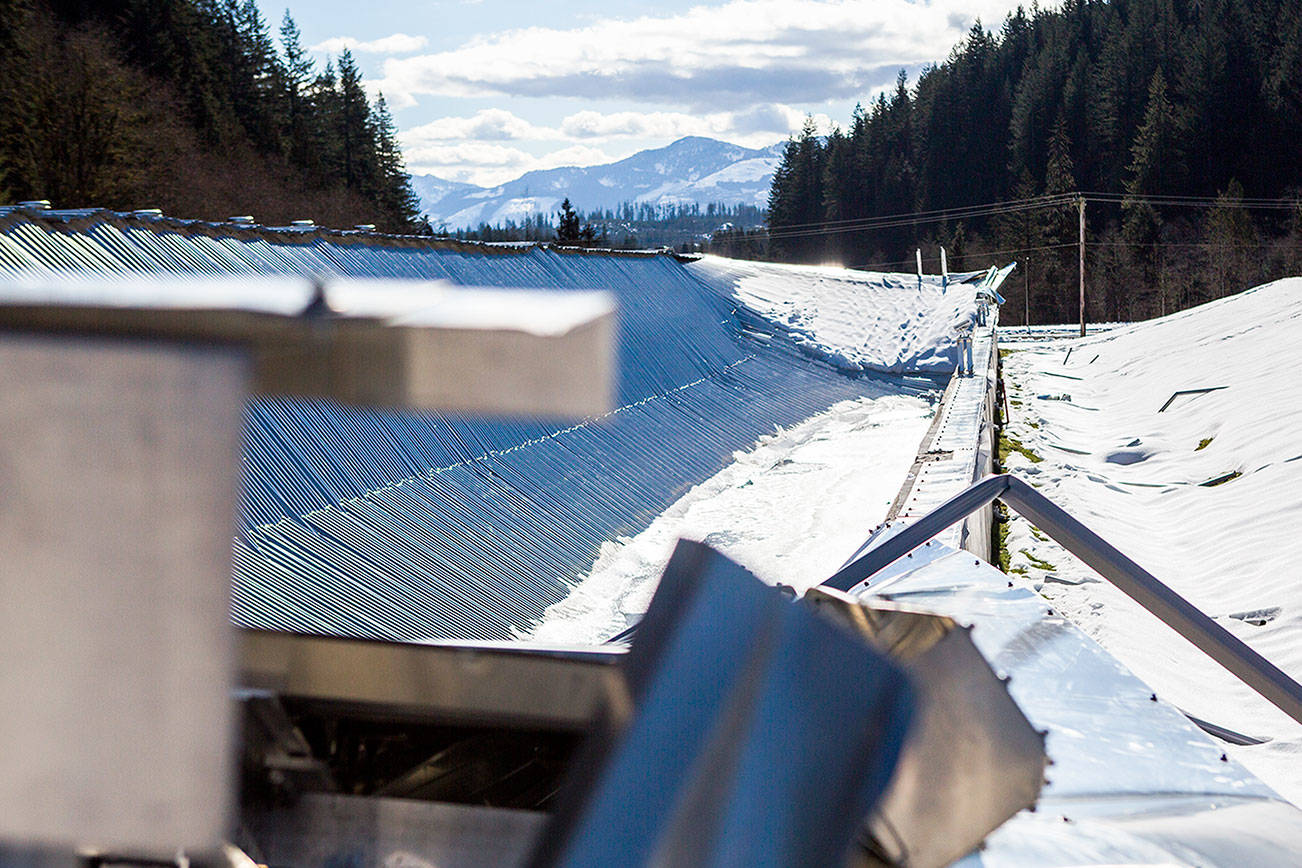 Ice and snow sit on top of a storage basin's collapsed roof at the city of Everett's water filtration plant near Monroe after the damage occured in February. (Olivia Vanni / Herald File)