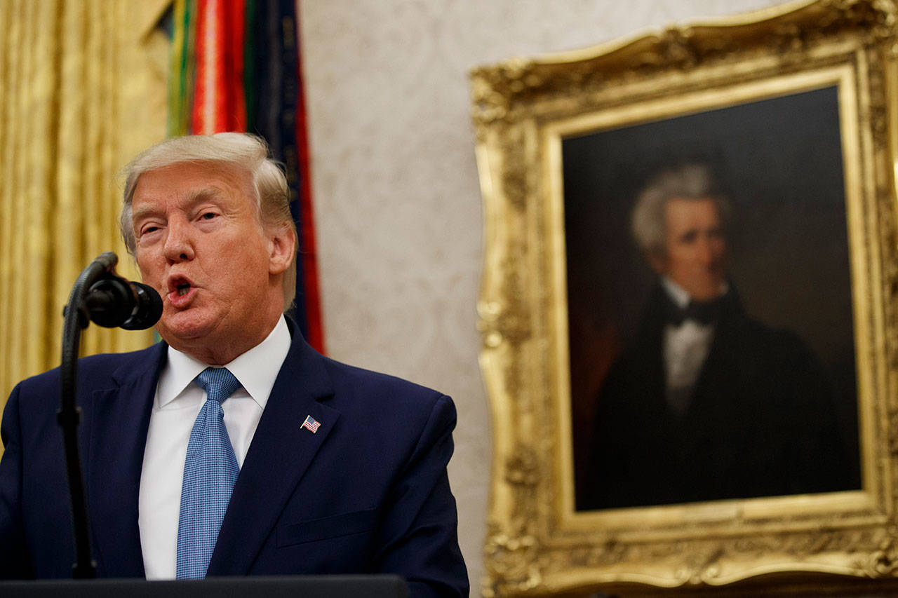 President Donald Trump speaks during a ceremony to present the Presidential Medal of Freedom to former Attorney General Edwin Meese, in the Oval Office of the White House on Tuesday. (AP Photo/Alex Brandon)