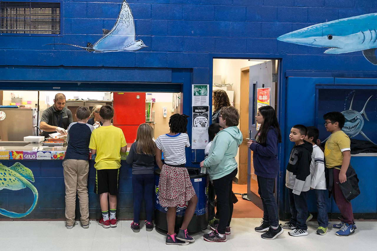 Students line up for a meal at Shoultes Elementary School in Marysville in October 2018. (Kevin Clark / Herald file photo)