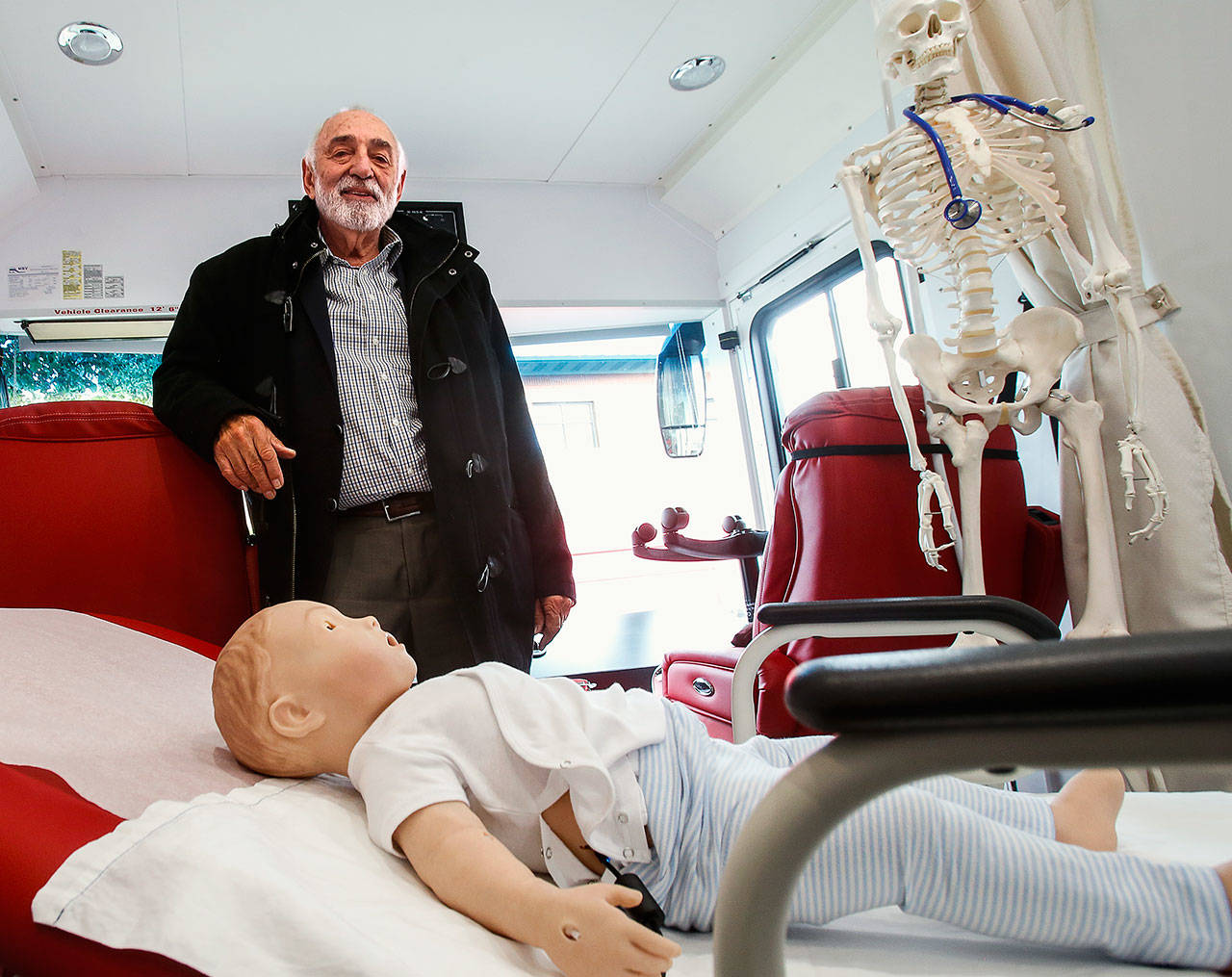Dr. Larry Schecter, associate dean of clinical education-Everett with WSU's Elson S. Floyd College of Medicine, shows off the new Range Health mobile medical unit in Everett on Thursday. It features two exam rooms, and high-fidelity mannequins used for simulated patient care. (Dan Bates / The Herald)