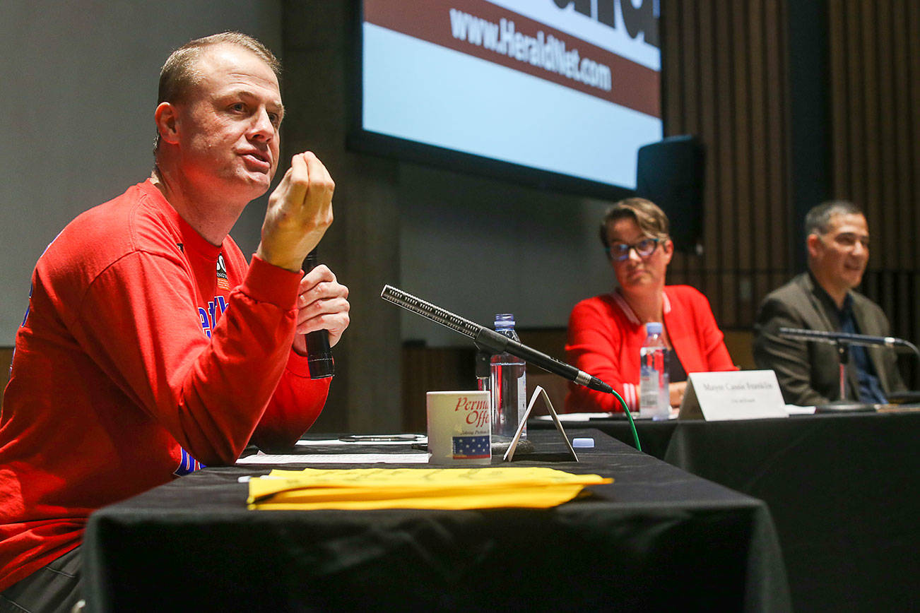 Sparks fly at I-976 debate: Eyman vs. a mayor and a senator