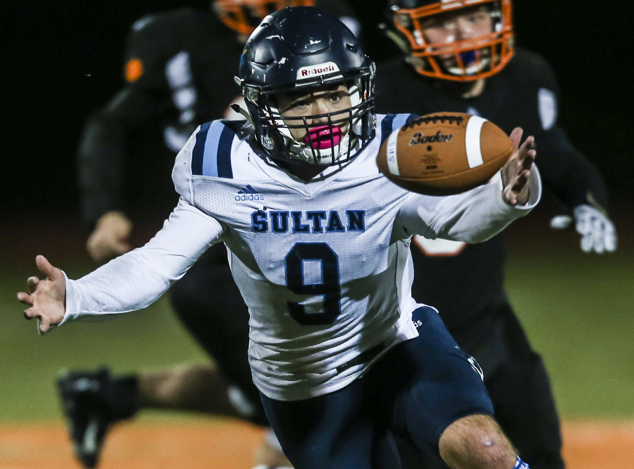 Sultan's Zane Sailor bobbles the ball during the game on Friday, Oct. 18, 2019 in Granite Falls. (Olivia Vanni / The Herald)