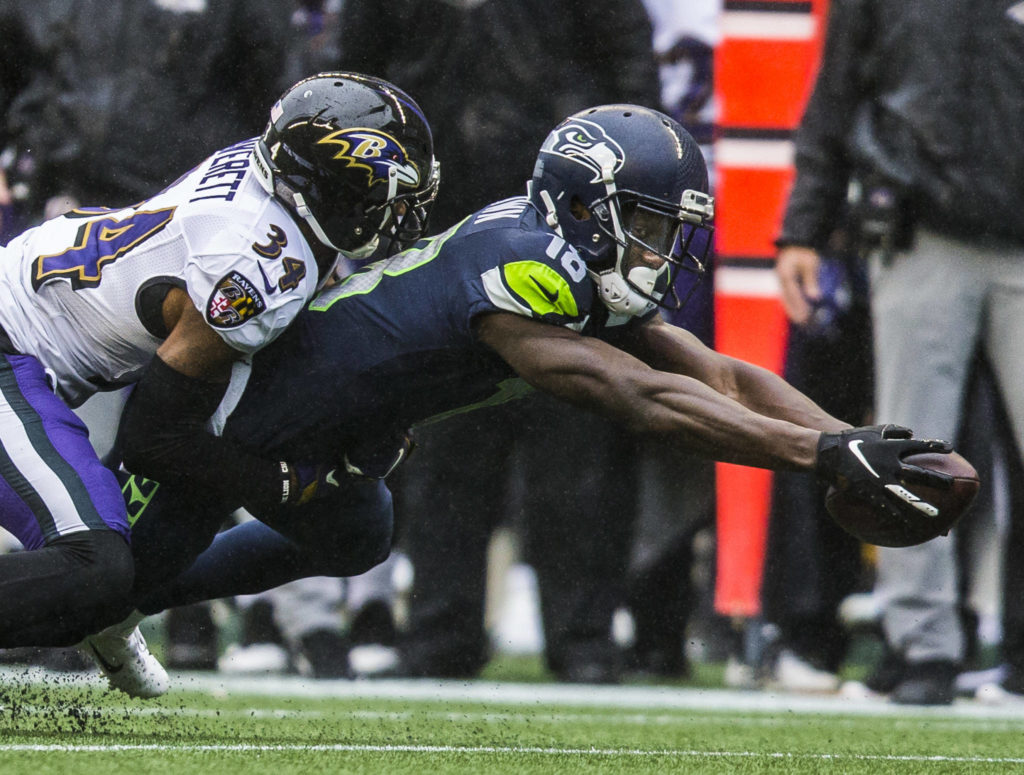 Seattle Seahawks' Jaron Brown reaches out his arms for a first down during the game against the Baltimore Ravens on Sunday, Oct. 20, 2019 in Seattle, Wash. (Olivia Vanni / The Herald)