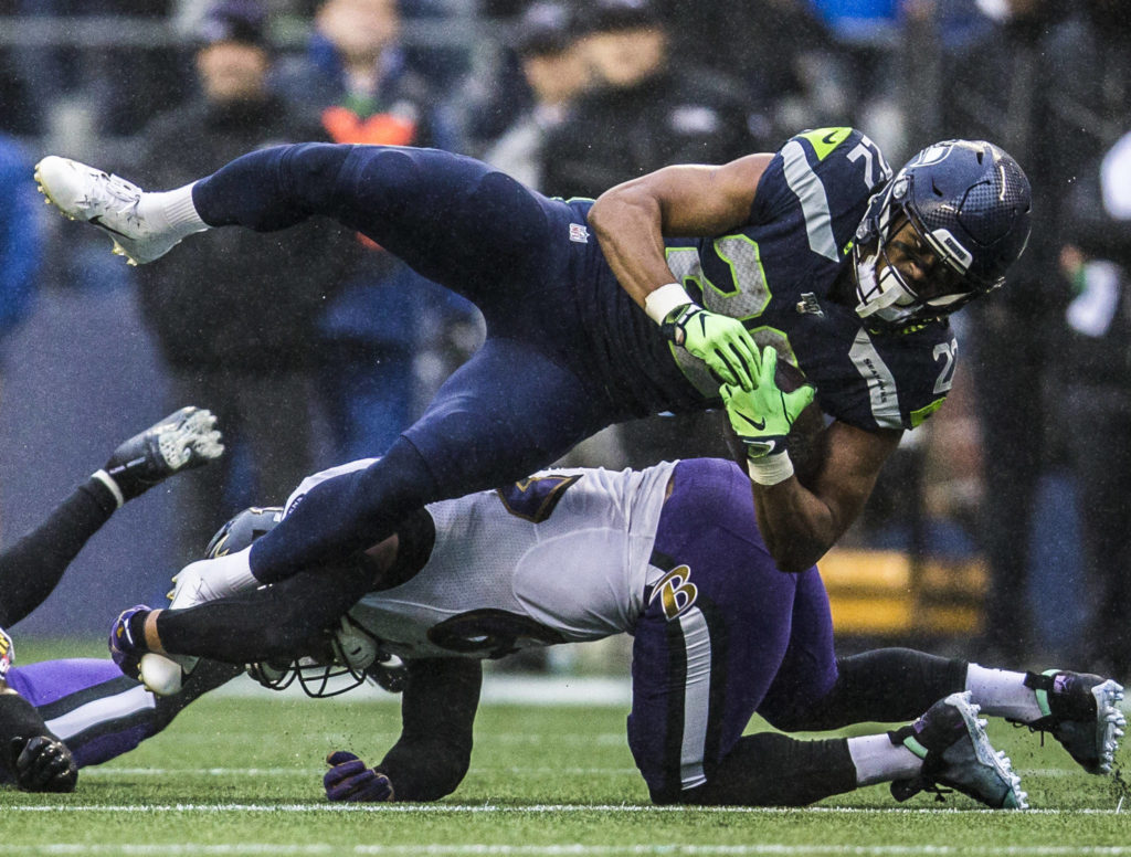 Seattle Seahawks' C.J. Prosise is tackled during the game against the Baltimore Ravens on Sunday, Oct. 20, 2019 in Seattle, Wash. (Olivia Vanni / The Herald)