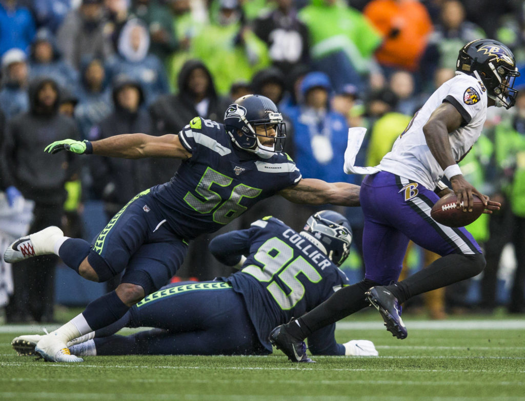 Seattle Seahawks' Mychal Kendricks reaches out to try and tackle Baltimore Ravens' Lamar Jackson during the game against the Baltimore Ravens on Sunday, Oct. 20, 2019 in Seattle, Wash. (Olivia Vanni / The Herald)