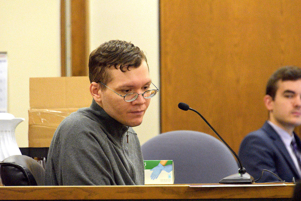 Anthony Garver glaces downward during his testimony Friday in Snohomish County Superior Court. (Caleb Hutton / The Herald)