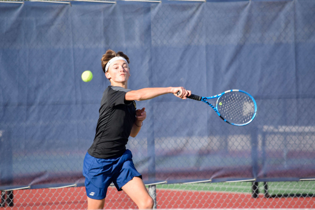 Lynnwood's Nicolas Desgrippes plays in the 3A district tennis singles final on Wednesday, Oct. 30 at Arlington High School. (Katie Webber / The Herald)