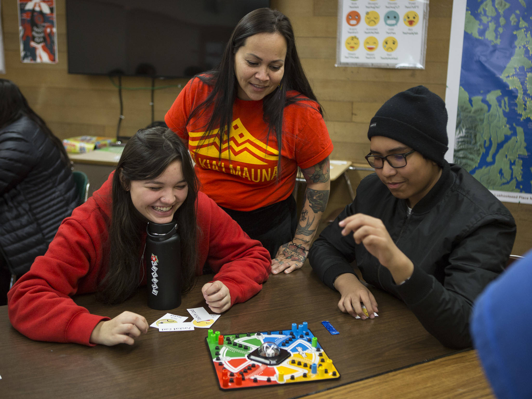 Natosha Gobin, center, watches as her students Angel Cortez, left, and Randy Vendiola, right, play a word matching game during Lushootseed class at Marysville Pilchuck High School on Nov. 1. (Olivia Vanni / The Herald)