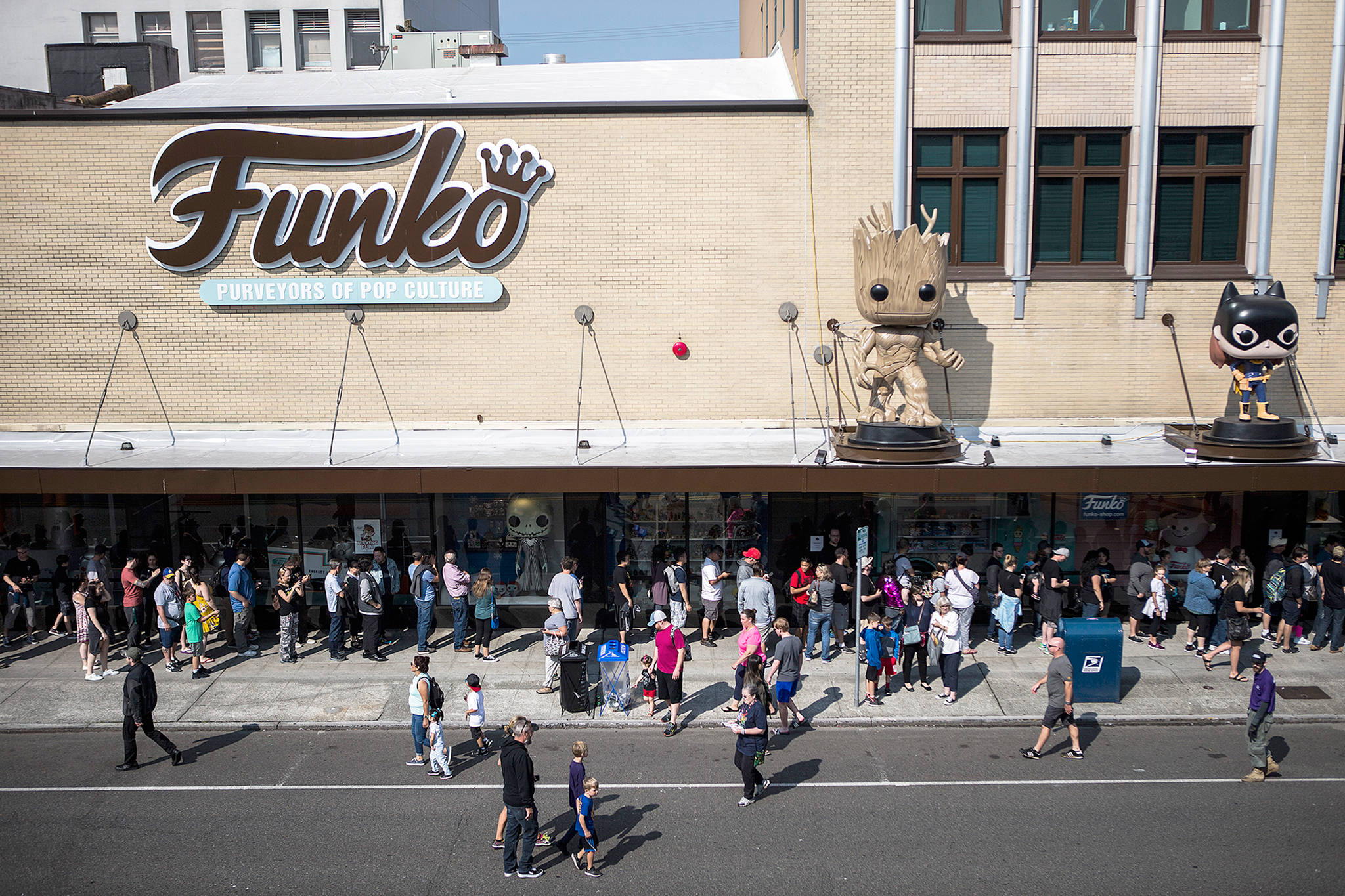 Olivia Vanni / The Herald                                 People line up to enter the Funko store in Everett in 2018.