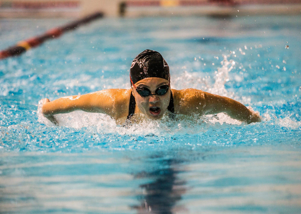 Stanwood High School's Jetlynn Hau swims the 200 individual medley Nov. 10, 2018, during the 2018 WIAA State Swim & Dive Championships in Federal Way. (Olivia Vanni / The Herald)