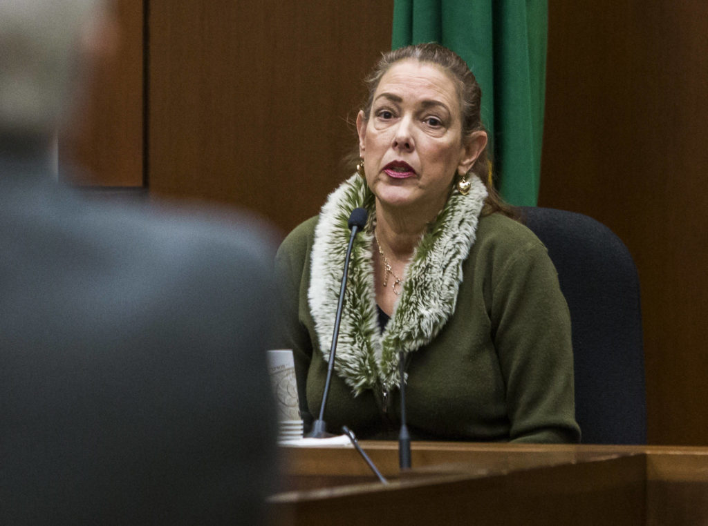 Bibianna Martinez-Benson, a family friend of Jerry Wood's mother, testifies at the Snohomish County Courthouse on Thursday. (Olivia Vanni / The Herald)