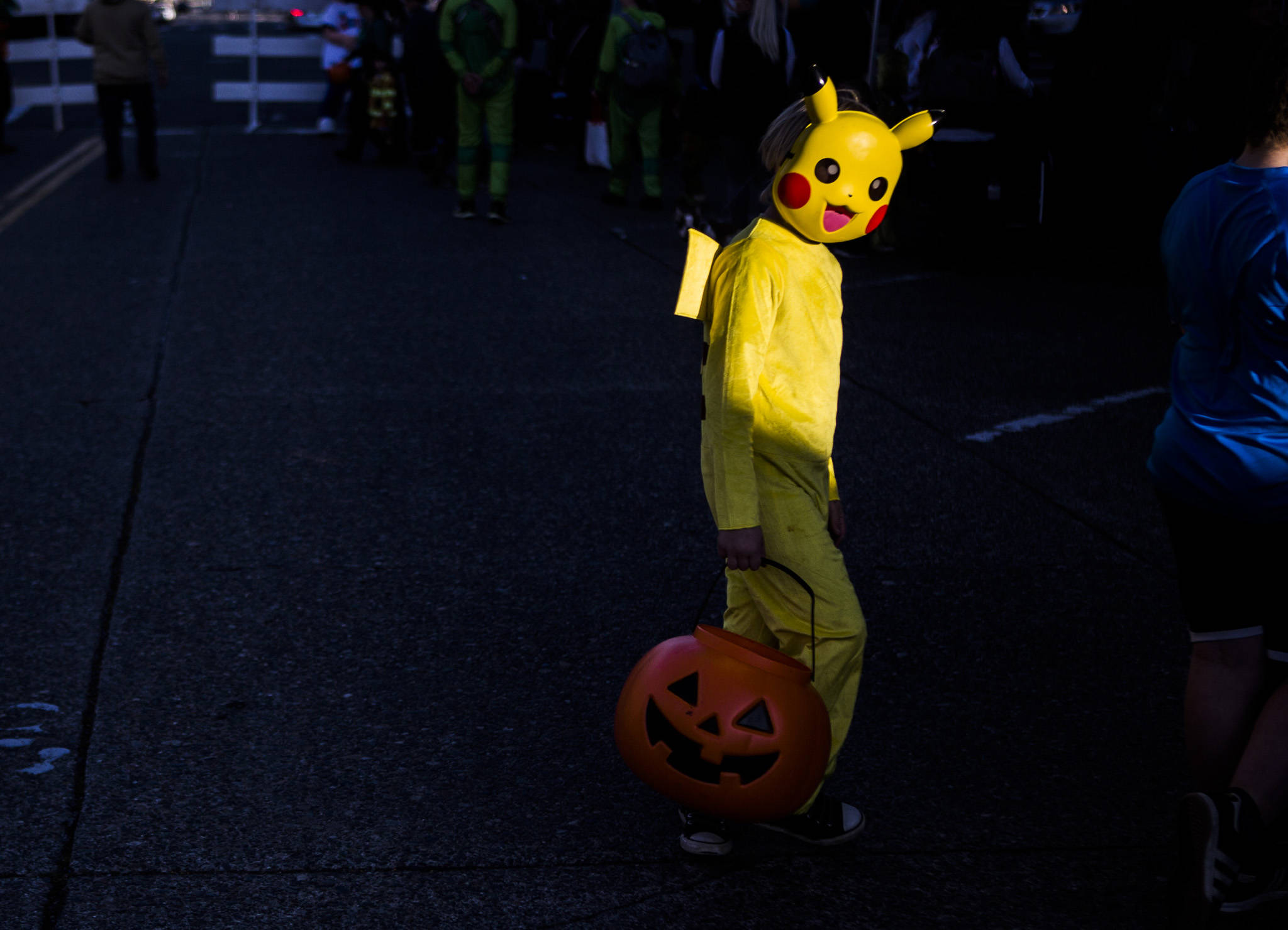 A Pikachu walks across California Street during downtown trick-or-treating Thursday in Everett. (Olivia Vanni / The Herald)
