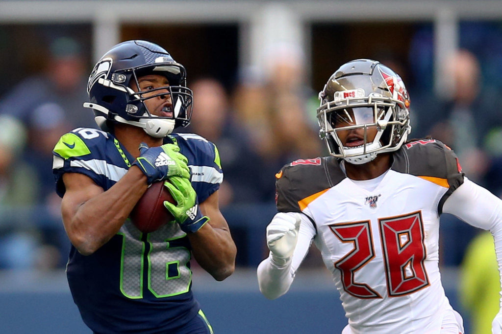 Seahawks wide receiver Tyler Lockett makes a key reception with Tampa Bay's Vernon Hargreaves III trailing Sunday afternoon at CenturyLink Field in Seattle. (Kevin Clark / The Herald)