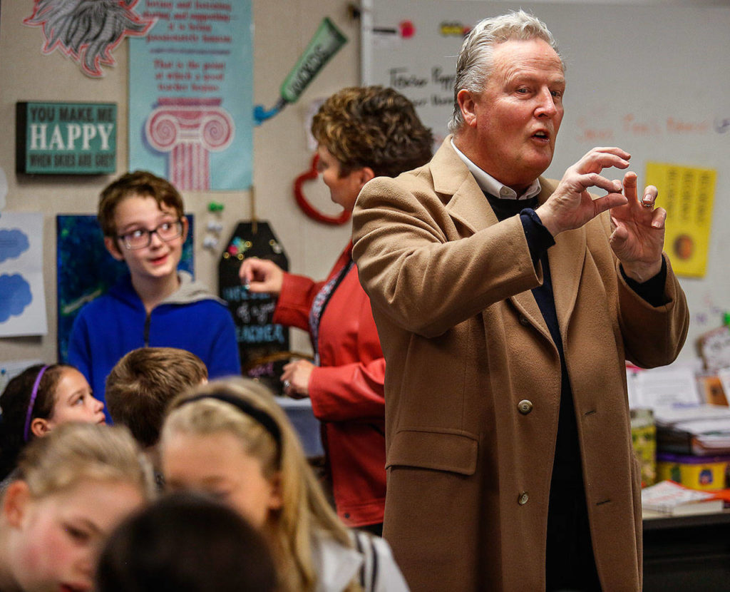 Seth Haney (left) talks with his teacher, Kimberlee Spaetig-Peterson, in her classroom at Riverview Elementary in Snohomish while Wonder Media CEO Terry Thoren explains his company's Story Maker technology. (Dan Bates/The Herald)