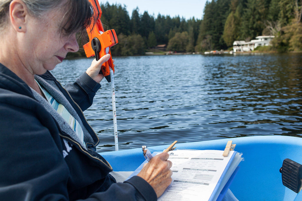 Deb Kocher is one of 73 volunteers monitoring 31 lakes through a Snohomish County Surface Water Management program. (Lizz Giordano / The Herald)