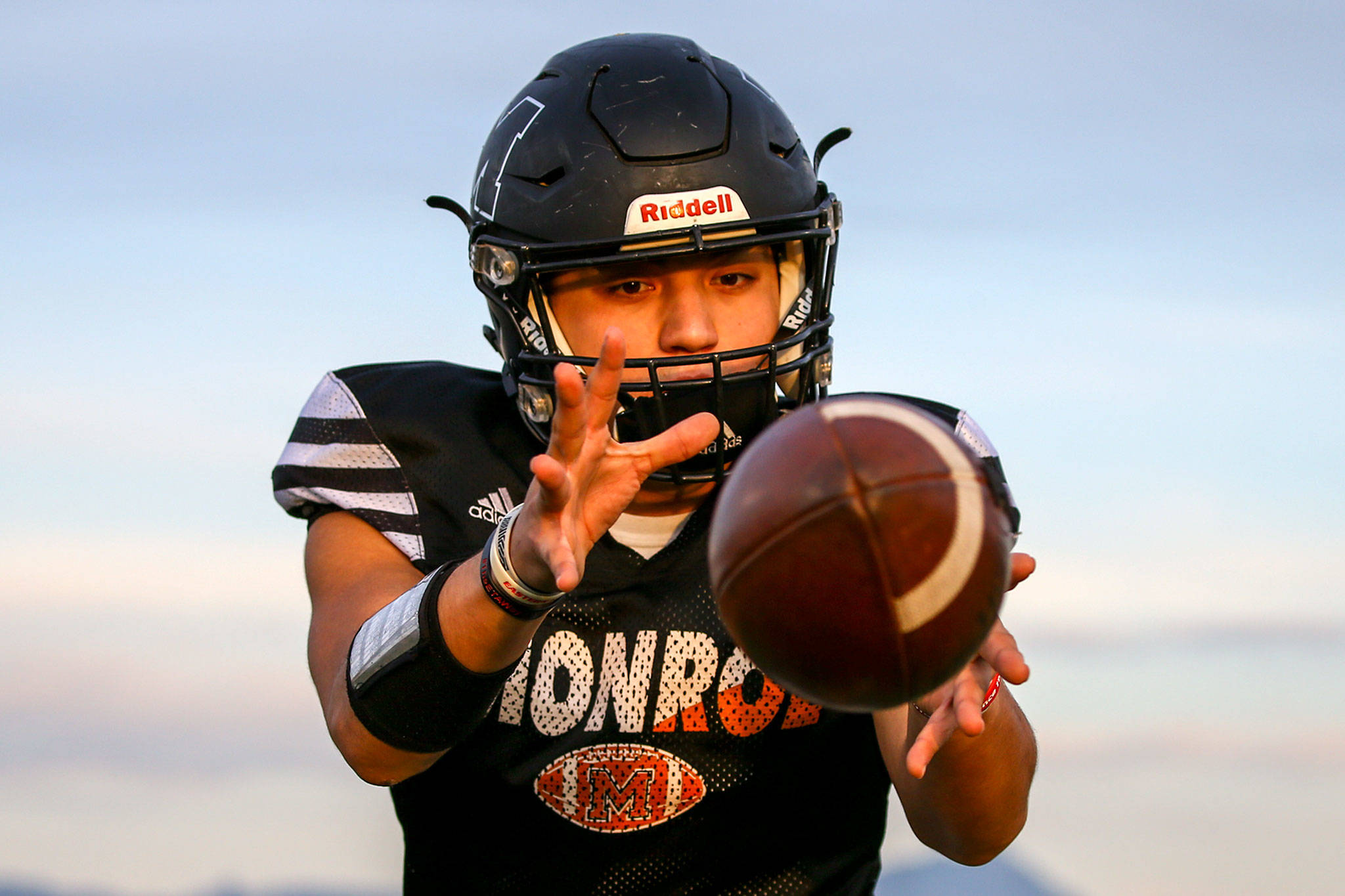 Monroe's Gio Fregoso receives the snap during practice Wednesday at Monroe High School. The Bearcats face Mount Si in a playoff game Saturday. (Kevin Clark / The Herald)