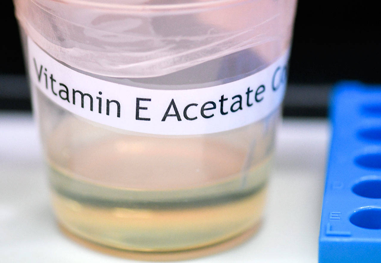 A vitamin E acetate sample is shown during a tour of the Medical Marijuana Laboratory of Organic and Analytical Chemistry at the Wadsworth Center in Albany, N.Y. on Nov. 4. On Friday, the Centers for Disease Control and Prevention in Atlanta said fluid extracted from 29 lung injury patients who vaped contained the chemical compound in all of them. (AP Photo/Hans Pennink)