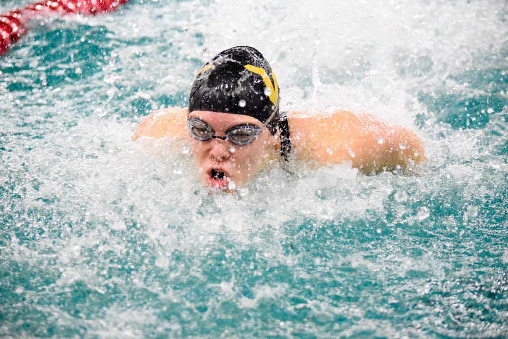 Lake Stevens' Aaliyha Fricke swims the third leg of the girls 200 yard medley relay of the 4A Girls Northwest District Championship on Nov. 9 at the Snohomish Aquatic Center. Lake Stevens won with a time of 1:52.86. (Katie Webber / The Herald)