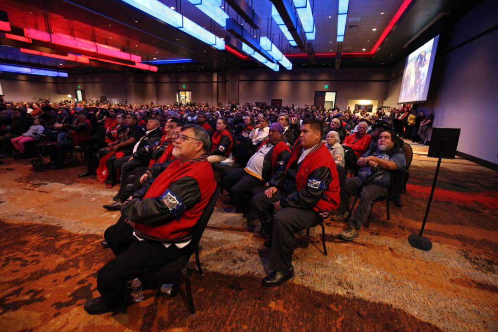 In was standing room only as family and guests watch a video showing the life of Tulalip Tribes' longest serving board member and chairman Stan Jones Sr. on Tuesday in Tulalip. (Andy Bronson / The Herald)